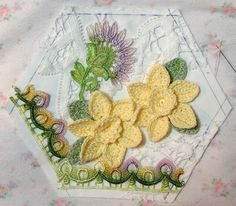 This is Hexie 32 with a few white and a few green beads added. Embellishing to continue, by Rhonda Dort.