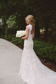 Gorgeous summer pastel wedding in charming Charleston, SC. Bride wearing an elegant lace wedding dress with keyhole back by Maggie Sottero.