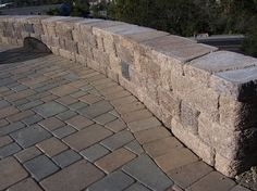 Seating walls are great for both garden focal points and overflow seating in the garden. This one is made from Country Manor Keystone. The 2 Minute Gardener is a great source for garden ideas with over 600 photos to inspire you. @ its-a-green-life