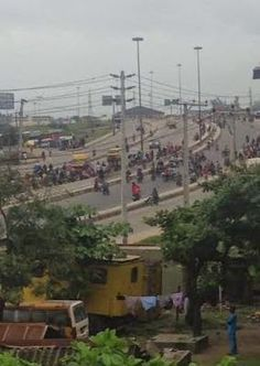ECHOES: RAW PHOTOS: Police and Okada men face off at Mile 2 in Lagos...