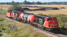 CN is testing two retrofitted diesel 3,000-horsepower locomotives in northern Alberta (on the 300-mile run north from Edmonton to Fort McMurray) fuelled primarily by natural gas instead of diesel to lower fuel costs and reduce carbon dioxide emissions.  The hybrid engines are burning 90 per cent natural gas, with 10 per cent diesel fuel for ignition. They are expected to reduce CO2 emissions by 30 per cent and NO2 emissions by 70 per cent over a locomotives life cycle, CN said.