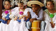 Adorable little kids wearing beautiful folkloric Panamanian costumes.  Cute, yet not too thrilled about it.