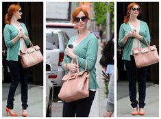christina hendricks turquoise sweater white tank top red hair pale pink purse dark denim jeans orange heels