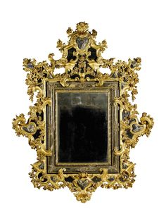 Carved and painted giltwood and faux marble mirror, Italian, 18th century.
