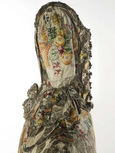 Spitalfields silk dress worn by Ann Fanshawe, Lady Mayoress in 1752, daughter to Lord Mayor of London Crisp Gascoyne. Dress in the Collection of the Museum of London.  Cream silk ground brocaded with polychrome silks and silver metal thread.