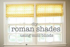 DIY roman shades using mini blinds (If you repin and try this, I highly recommend lining your curtains. It looks SO MUCH MORE PROFESSIONAL, keeps your fabric from fading, costs very little extra money, and it's easy to do.)