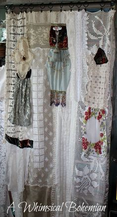 We hung 2 rods, one high and one low. I have a huge bag of old lace doilies and table cloths and all sorts of things I've collected for YEARS and YEARS. I got the bag out and with needle and thread began creating curtains I would hang from rings.