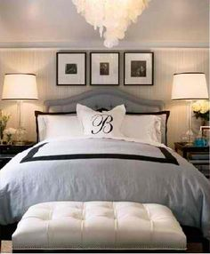 love the nightstands, bench at the foot of the bed, and matted frames