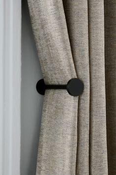 Minimal and stylish, these holdbacks are the perfect solution to keeping your curtains neat and adding extra style to your space. Screws not included. The diameter of stud end: Black Curtain Holdbacks, Black Curtain Pole, Curtain Tie Backs, Living Room Decor Curtains, Home Curtains, Curtains With Blinds, Black Curtains Bedroom, Elegant Curtains, Modern Curtains
