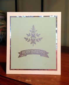 Silver foil card with heat embossing.
