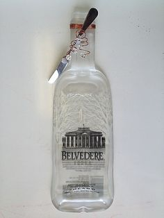 This repurposed Belvedere Vodka bottle is an ideal gift for vodka lovers!  Serve cheese, appetizers and more at your next party. #Belvedere #BottleArt http://www.WineYesPlease.com