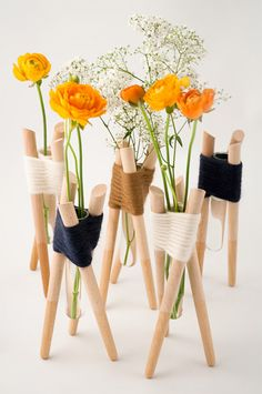 Buy or DIY: Yarn Wrapped Forget Me Not Vases. Try crafting your own with some basic wooden dowels, test tubes, and yarn as a way to display single stems beautifully! Or for ordering information, email info@aurelierichard.com. http://www.apartmenttherapy.com/buy-or-diy-forget-me-not-vases-179990#