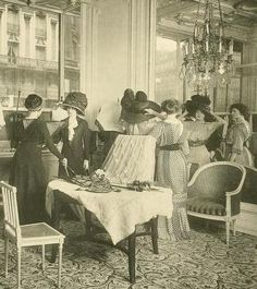 Buying Hats in Paris Salon in 1910....she certainly hoped her hat would be the most original, the cost was outrageous!....