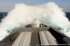 Type 45 destroyer HMS Dauntless cuts through rough weather in the South Atlantic during her deployment to the area.