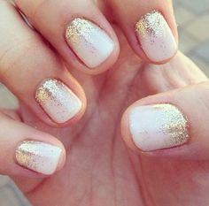 Whit with gold glitter nails