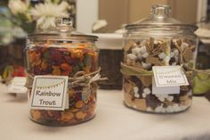 Camping 1st Birthday Party:  Trail Mix Bar where guests could fill a mason jar with their custom mix...click photo to see all the cleverly-named choices!