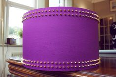 Magenta purple gold studded lampshade  www.bexandwhistles.com  http://www.facebook.com/BexandWhistles  Magenta purple cotton with gold frame and studding  size 3 - 40cm diameter x 25cm high  £105 / €122  SAMPLE PRODUCT CURRENTLY AVAILABLE AT A REDUCED COST. PLEASE ENQUIRE
