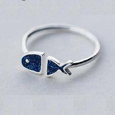 - Material: Sterling Silver w/ Blue Enamel Finish On Face - Stones: None - Face Height: 5 mm - Band Width: 2 mm - Size (Adjustable) Fish Design, Adjustable Ring, Ring Designs, Heart Ring, Silver Rings, Stones, Rings, Rocks, Stone