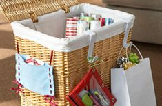 Clothes hamper converted into gift wrap storage.
