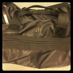 Kyodan Gym Bag This Kyodan Gym bag needs new home! There are some scratches from use on the bottom but otherwise the top and insides of bag are in excellent condition. There is an area for a yoga mat in the front and a hidden pocket for dirty gym clothes. Kyodan Bags Travel Bags