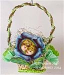 Blue Primrose with Children's Faces 2-tone Green Crepe Paper Basket. Handmade OOAK by Dresden Star http://www.hometraditions.com/category_s/1909.htm
