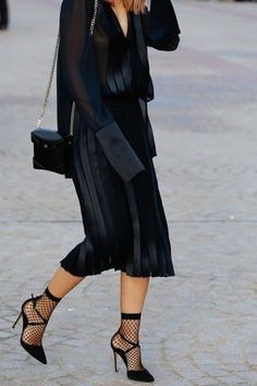 black on black street style; fashion week; socks with pumps