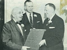 Albert Sachachat, Hubbard Shoe Co presents TKH Award to Kivie Kaplan, Colonial Tanning Co. Wendell Bauckman (president of Two Ten) in middle.