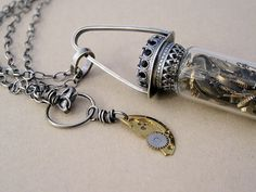 Glass Vial Necklace with Watch Parts Vintage. Interesting idea I'd like to try.
