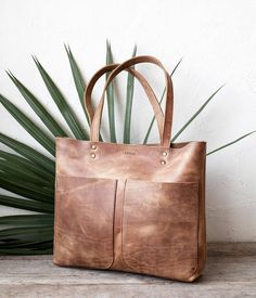 Distressed Camel high quality genuine Italian leather. Rustic aged look leather. Can be used as daily bag, shopper, travel, school bag. Perfect to carry many things: Laptop (fits 15 macbook pro), magazines, books, ipad, and more... Size: Height: 31cm x Width 40cm top - 36cm bottom Strap