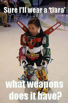 thedaddycomplex:    Radness. Not sure why tiara is in single quotes, but whatever. Web grammar.  Also, if you have this costume in adult size, I'd gladly kill your enemy to have it.  (via essenceofculture)      That's what I like to see, girls who can kick ass!