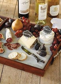 Present your finest cheeses and wine party finger foods in impeccable taste atop the Tuscan Cheese Serving Tray Set.