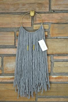 Gray natural fiber wall hanging macrame tapestry on by AstralRiles. Possible DIY?
