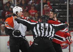 Devils vs. Flyers - 04/16/2010 - New Jersey Devils - Photos EWARK, NJ - APRIL 16: Arron Asham #45 of the Philadelphia Flyers and David Clarkson #23 of the New Jersey Devils are separated by linesman Jay Sharrers in Game Two of the Eastern Conference Quarterfinals during the 2010 NHL Stanley Cup Playoffs at the Prudential Center on April 16, 2010 in Newark, New Jersey. The Devils defeated the Flyers 5-3. (Photo by Bruce Bennett/Getty Images)