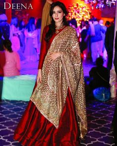 Our creative director, Deena Rahman wears red and gold. Shadi Dresses, Pakistani Formal Dresses, Pakistani Wedding Outfits, Indian Gowns Dresses, Bridal Outfits, Indian Attire, Indian Outfits, Indian Wear, Desi Wedding Dresses