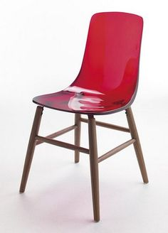 The pretty Pauline OM Wood Base Chair, designed by French designer, Thibault Desombre.