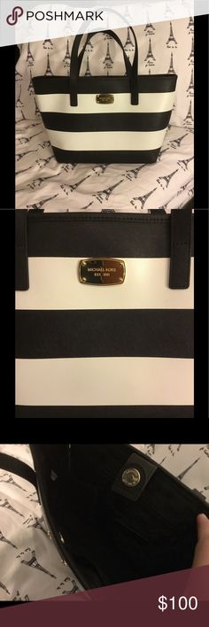 Michael Kors Over-The-Shoulder Purse This very elegant black and white stripe purse is one of my favorites. In Excellent condition! The magnetic clip strap going into the inside has a little ding on it, but you can barely tell! It has pockets in the inside, and a small pocket in the back for your items. The gold emblem has a couple scratches, but again, nothing that takes the beauty away! It is a nice material that you can wipe off with a wet towel. This purse styles well with almost…