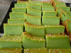 KUEH BAKAR // 1 1/4 C sugar, 2 C flour, 1 C pandan juice (6 pandan leaves + 1 cup water - blended), 2 1/4 C coconut milk, 4 large eggs, 2 T melted butter, 1 t pandan paste, few drops of green food coloring (optional), 1 T sesame seeds (optional)
