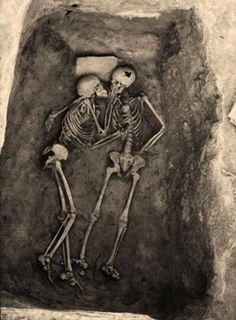 """The """"Hasanlu Lovers"""", a pair of entwined skeletons who died together in about 8oo B.C.These skeletons, which represent two persons in embrace of each other, have been found in ancient Hasanlu site in West Azarbaijan, about early 70s. It is estimated that these people lived in eight hundred years BC. Nothing has been found with these two skeletons except the stone that is over the head of the person in the left"""