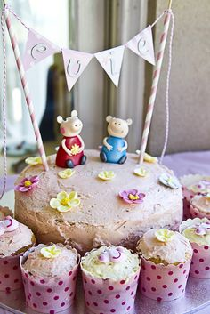 What a sweet Peppa Pig birthday cake and cupcakes! See more party ideas at CatchMyParty.com. #peppapig #girlbirthday #partyideas #birthdaycake