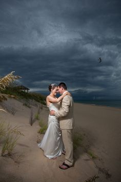 Cloudy skies can make for some dramatic pictures.   Photo by Coleman Shots www.engagingeventsobx.com #engagingeventsobx #outerbankswedding