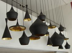 Love these Tom Dixon black pendants - they are like fab art pieces