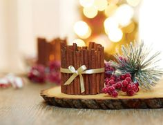 I can definitely make this, Cinnamon Stick Votive and must get the wood block for the base as well!