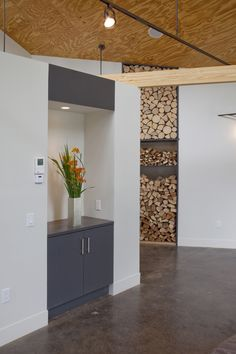 A Civilized Factory by Burr McCallum Architects : Remodelista Looks better if logs go floor to ceiling Remodelista, Hall Design, Industrial Inspiration, Cheap Log Cabins, Firewood Storage, House, Home Decor, House Interior, Log Homes