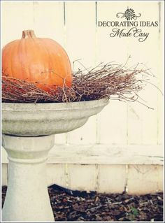 Fall Yard Decoration - grapevine twig wreath and a beautiful pumpkin. This idea would be nice as substitute at porch or front step instead of planters.