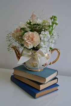 Alice in Wonderland wedding flowers, Tea pot, Disney, stacked books