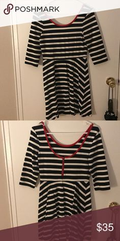 Striped A line dress with low back Short black and white A line dress with red detailing scoop neck. Low back cut with short zipper Express Dresses Mini