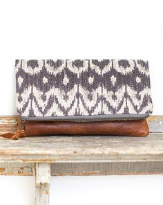 Beautiful mix of leather and pattern design,soft natural colours are a winner here!