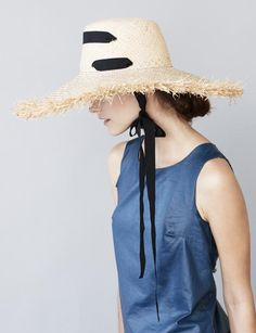 Made from an ultra-flexible woven raffia, the Alpargatas has a bucket crown that sits slightly higher on the head than a conventionally fitting hat. The brim is top-stitched and has a fringed edge. A long grosgrain ribbon is threaded through eyelets to serve as a chin tie. Knot it under your left ear for a chic touch, or just let the hat hang nonchalantly down your back like a '40s señorita!