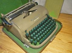Old typewriter. Wow! I forgot until I saw this picture, but my parents had one just like this when I was a kid. Fit in the case just the same, same color...identical. I loved to type on it. :)