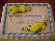 Yellow & Blue Anniversary Cake - I've been selling a lot of this design lately. This one is a 1/4 sheet, marble cake, iced in buttercream. Buttercream roses and fondant daisies.